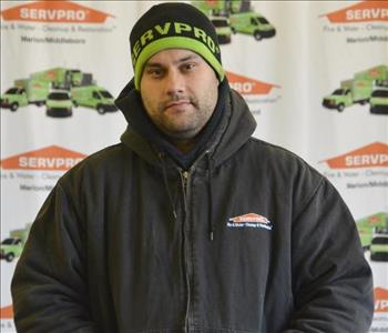 Male standing in front of SERVPRO backdrop