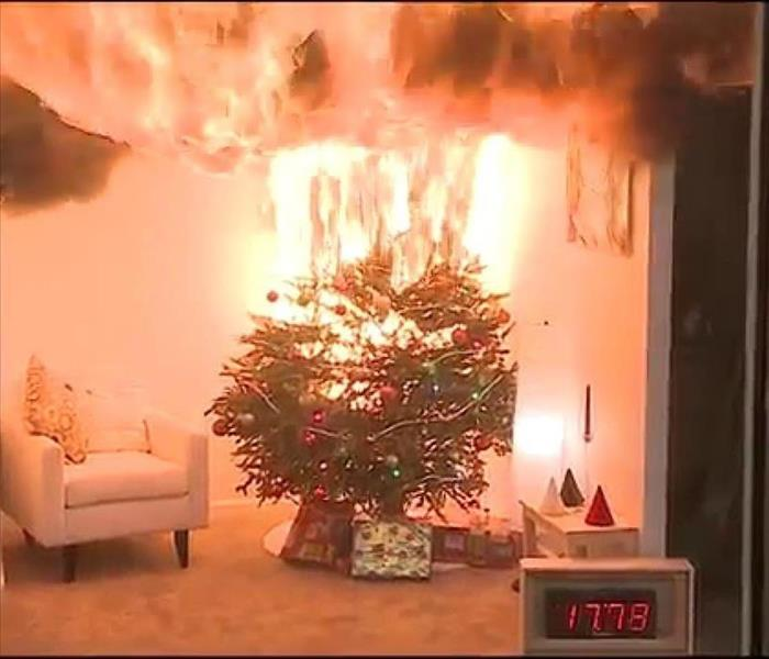 a dry Christmas tree catching on fire